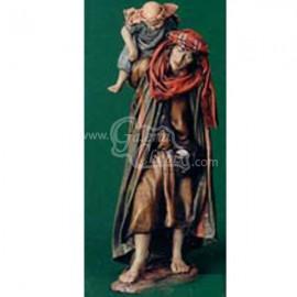 Pastor con niño al hombro