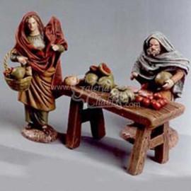 Pastores en puesto de fruta