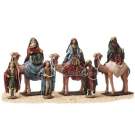 Reyes a caballo con pajes