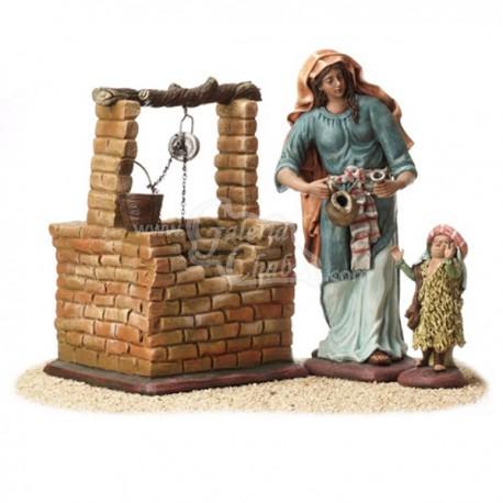 Pastora y niño en pozo