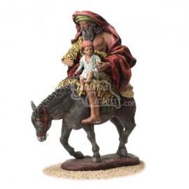 Pastor y niño en burro