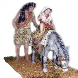 Pastor y niño con mula de carga