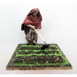 Pastor trabajando la tierra