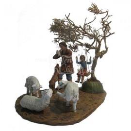 Pastor con ovejas, perro y niño en columpio