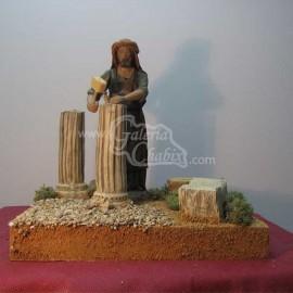 Pastor móvil esculpiendo columna