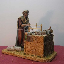 Pastor móvil serrando tronco